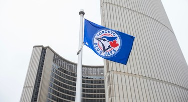 The Toronto Blue Jays flag flies at City Hall on the Podium Green Roof at in Toronto, Ont.  on Tuesday October 6, 2015. The flag raising was to kick of the Toronto Blue Jays 2015 playoff action. Ernest Doroszuk/Toronto Sun/Postmedia Network