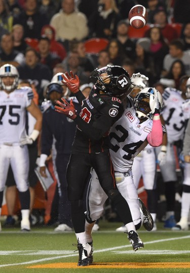 Ottawa Redblacks wide receiver Chris Williams (80) can't hold on to the pass as Toronto Argonauts' A.J. Jefferson (24)defends during first quarter CFL action in Ottawa on Tuesday, Oct 6, 2015. THE CANADIAN PRESS/Sean Kilpatrick