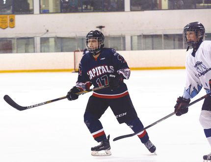 Central Plains Capitals forward Sheridan Oswald, left, works alongside an Interlake player during her team's 7-2 win Monday. Oswald, a MacGregor, Man. native, recorded a hat trick to pace Central Plains' offence. (submitted photo)