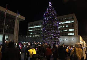 A crowd mills around following the annual lighting of the Christmas tree at City Hall on Main Street on Fri., Nov. 14, 2014.