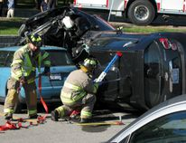 Firefighters use struts to stabilize vehicles involved in a collision at St. Lawrence Lodge Thursday afternoon. (SUBMITTED PHOTO)