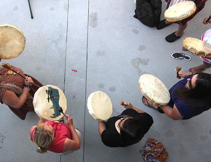 Students from an aboriginal school perform a drum song during national Aboriginal Day festivities. Postmedia Network