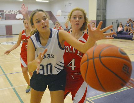 Valley Heights' Corina Reimer loses possession of the ball while being cornered by Waterford's Liz Marr, during a NSSAA senior girls basketball game Thursday afternoon at Valley Heights Secondary School. The Bears defeated the Wolves 21-17. (EDDIE CHAU Simcoe Reformer)
