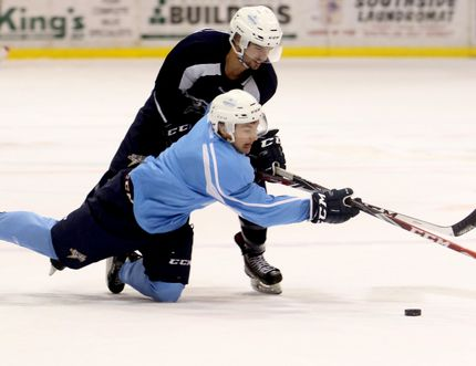 Tristan Crozier and Landon Vollman battle for positioning during Grande Prairie Storm practice on Wednesday at Revolution Place. Logan Clow/Daily Herald-Tribune