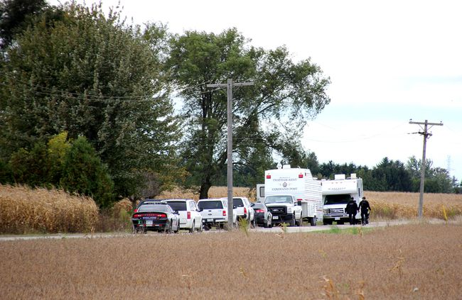 A heavy Chatham-Kent police presence is shown at a residence on Morris Line near Merlin Road in Tilbury East in October. Police said approximately 40 dogs were seized from the property and placed into the care of the OSPCA. (TREVOR TERFLOTH, The Daily News)