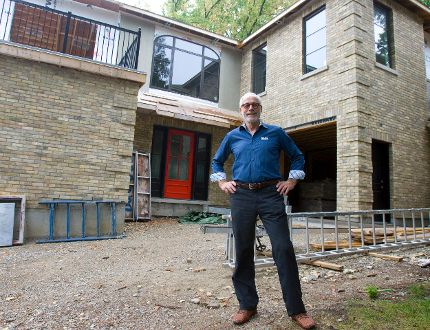 Patrick Malloy, owner of Duo Building Ltd., in front of a 'green' renovation project in London. Malloy says only about one in 50 homeowners is interested in such responsible building practices. (DEREK RUTTAN, The London Free Press)