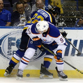 Edmonton Oilers' Connor McDavid, front, collides with St. Louis Blues' Kevin Shattenkirk along the boards during the first period of an NHL hockey game Thursday, Oct. 8, 2015, in St. Louis. (AP Photo/Jeff Roberson)