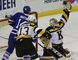 Kingston Frontenacs goalie Lucas Peressini makes a glove save as teammate Konstantin Chernyuk and Mississauga Steelheads Nathan Bastian look on during Ontario Hockey League action at the Rogers K-Rock Centre in Kingston on Friday. Ian MacAlpine/The Kingston Whig-Standard/Postmedia Network