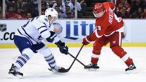 Red Wings left wing Justin Abdelkader (right) shoots past Maple Leafs defenceman Scott Harrington (left) to score a goal during the first period at Joe Louis Arena in Detroit on Friday, Oct. 9, 2015. (Tim Fuller/USA TODAY Sports)
