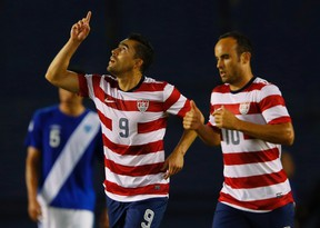 U.S forward Herculez Gomez (9) celebrates his first half goal with teammate Landon Donovan after scoring against Guatemala during their friendly soccer match in San Diego, California July 5, 2013. The friendly is a tune-up game for the American team before entering into the CONCACAF  Gold Cup.  REUTERS/Mike Blake