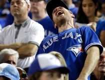 Fans react to the Toronto Blue Jays losing to the Texas Rangers in the 14th inning during game 2 of the best-of-five American League Division Series at the Rogers Centre in Toronto, Ont. on Friday October 9, 2015. Craig Robertson/Toronto Sun/Postmedia Net