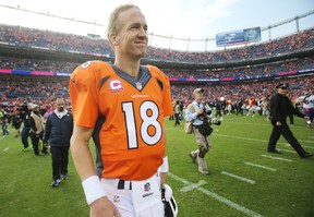 Denver Broncos quarterback Peyton Manning (18) after the game against the Minnesota Vikings at Sports Authority Field at Mile High. The Broncos won 23-20. Mandatory Credit: Chris Humphreys-USA TODAY Sports