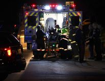 A Niagara Regional Police officer is loaded into an ambulance after being shot at a Fenwick apartment building Saturday night. (Greg Furminger/Welland Tribune/Postmedia Network)