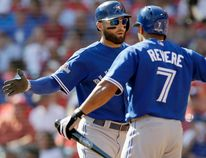 Toronto Blue Jays center fielder Kevin Pillar (11) celebrates his home run against the Texas Rangers with left fielder Ben Revere (7) during the second inning in Game 4 of baseball's American League Division Series Monday, Oct. 12, 2015, in Arlington, Texas. (AP Photo/LM Otero)