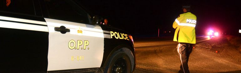 Perth County OPP remained on the scene at Perth Road 119 and Perth Line 56 at the Topping curve late Monday as they investigated a fatal single-vehicle rollover north of Stratford.