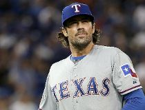 Cole Hamels #35 of the Texas Rangers walks off the mound at the end of the second inning against the Toronto Blue Jays during game two of the American League Division Series at Rogers Centre on October 9, 2015 in Toronto, Canada.   Tom Szczerbowski/Getty