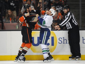 Ducks defenceman Clayton Stoner (left) fights against Canucks right wing Brandon Prust (right) during first period NHL action in Anaheim on Monday, Oct. 12, 2015. (Gary A. Vasquez/USA TODAY Sports)