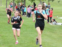 The Bluewater Southern Area Cross Country Meet saw Huron Heights Public School, Elgin Market Public School, Kincardine Township Tiverton Public School and Lucknow Central Public School take over the Ainsdale Golf Course for the afternoon on Oct. 8, 2015. Huron Heights topped the schools with efforts like the three senior girls pictured above. Rylee Pawlikowski, left, pushed herself hard from behind her friend and training partner Kaleigh Auer to take the win by a nose, with Paige Auer finishing third a few steps behind. (SUBMITTED PHOTO)