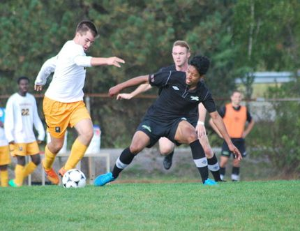 Cambrian College Golden Shield's Aaron Dent handles the ball against an Algonquin player during OCAA men's soccer play on Sept. 19 at Cambrian College. Dent sets the tone for