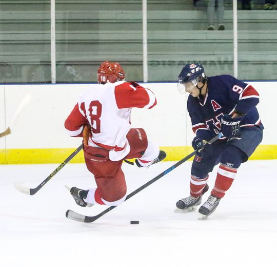 Wetaskiwin�s Tanner Posch trips up a Red Wing during Sunday night�s Junior B game at the Civic Centre.
