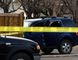 Tom Bateman/Daily Herald-Tribune Police tape marks a perimeter in the parking lot behind a set of townhouses along 100 Avenue, near 96 Street on Tuesday. A man's body was visible inside the blue Ford Escape.