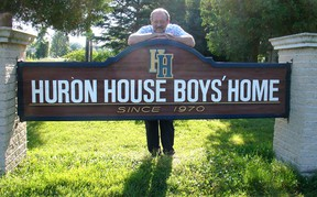Huron House Boys' Home executive director Don Adam stands at the sign for the Bright's Grove refuge for wayward boys. The mental health facility was holding an open house in honour of its 45th anniversary Thursday. Handout/Sarnia Observer/Postmedia Network