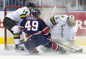 Saginaw Spirit forward Cole Coskey sends a cloud into London goalie Tyler Parsons as he attempts to score while under pressure from Knights defenceman Brandon Crawley at Budweiser Gardens on Friday night. (CRAIG GLOVER, The London Free Press)