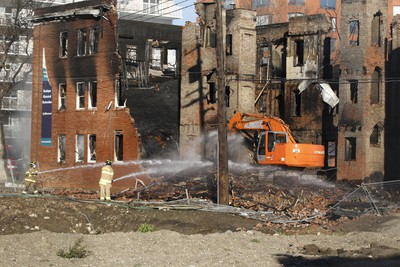 Fire crews work to douse hotspots after an early morning fire in downtown Edmonton leveled the century-old, heritage building, Leamington Mansions � which were originally built in 1914 and opened in 1918 � on Jasper Avenue and 114 Street in Edmonton, AB on Saturday, October 17, 2015. TREVOR ROBB/Postmedia Network