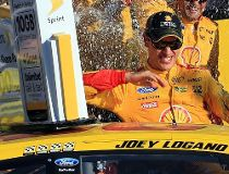 Joey Logano, driver of the #22 Shell Pennzoil Ford, celebrates in Victory Lane after winning the NASCAR Sprint Cup Series Hollywood Casino 400 at Kansas Speedway on October 18, 2015 in Kansas City, Kansas.   Daniel Shirey/Getty Images/AFP