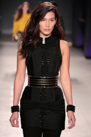 Model Bella Hadid walks the runway at the BALMAIN X H&M Collection Launch at 23 Wall Street on October 20, 2015 in New York City.