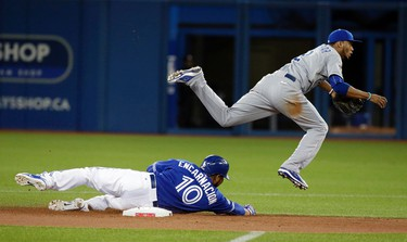 Edwin Encarnacion of the Toronto Blue Jays gets caught in the double play against Alcides Escobar of the Kansas City Royals during game 5 of the American League Championship Series at the Rogers Centre in Toronto, Ont. on Wednesday October 21, 2015. Craig Robertson/Toronto Sun/Postmedia Network