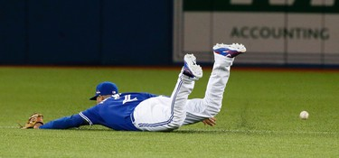 Troy Tulowitzki of the Toronto Blue Jays dives for a ground ball against the Kansas City Royals in the 4th inning during game 5 of the American League Championship Series at the Rogers Centre in Toronto, Ont. on Wednesday October 21, 2015. Stan Behal/Toronto Sun/Postmedia Network