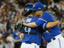 Dioner Navarro congratulates Roberto Osuna of the Toronto Blue Jays as they defeat the Kansas City Royals during Game 5 of the American League Championship Series at the Rogers Centre in Toronto, Ont. on Wednesday October 21, 2015. Stan Behal/Toronto Sun/