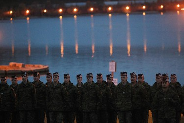 Argyll and Sutherland Highlanders stand at a Memorial for Cpl. Nathan Cirillo on Wednesday, Oct. 21, 2015, Hamilton, Ontario. Scores of people turned out under dark skies for a hilltop ceremony on Wednesday in honour of a soldier gunned down a year ago as he stood guard at the National War Memorial on Parliament Hill. THE CANADIAN PRESS/Dave Chidley