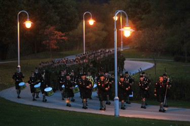 Argyll and Sutherland Highlanders march to a Memorial for Cpl. Nathan Cirillo on Wednesday, Oct. 21, 2015, Hamilton, Ontario. Scores of people turned out under dark skies for a hilltop ceremony on Wednesday in honour of a soldier gunned down a year ago as he stood guard at the National War Memorial on Parliament Hill. THE CANADIAN PRESS/Dave Chidley