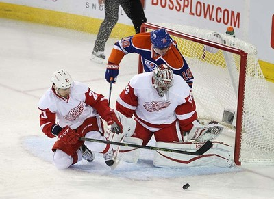 Edmonton Oilers' Nail Yakupov (10) is stopped by Detroit Red Wings' goalie Petr Mrazek (34)  and Tomas Tatar (21) during first period NHL action at Rexall Place in Edmonton, Alberta on October 21, 2015. Perry Mah/Edmonton Sun/Postmedia Network