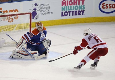 Edmonton Oilers' goalie Cam Talbot (33) stops Detroit Red Wings' Justin Abdelkader (8) during third period NHL action at Rexall Place in Edmonton, Alberta on October 21, 2015. Perry Mah/Edmonton Sun/Postmedia Network