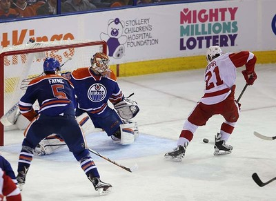 Edmonton Oilers' goalie Cam Talbot (33) is scored on by  Detroit Red Wings' Tomas Tatar (21) during third period NHL action at Rexall Place in Edmonton, Alberta on October 21, 2015. Perry Mah/Edmonton Sun/Postmedia Network