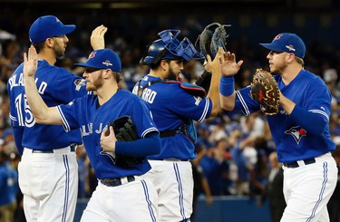 The Toronto Blue Jays celebrate winning against the Kansas City Royals during game 5 of the American League Championship Series at the Rogers Centre in Toronto, Ont. on Wednesday October 21, 2015. Stan Behal/Toronto Sun/Postmedia Network