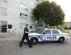 A police officer walks to his cruiser after responding to a stabbing at 114 Arbour Glen Crescent just after 9 a.m. on Thursday October 22, 2015. A six-year-old child is in serious condition, and an adult known to the child is in custody, according to police. (CRAIG GLOVER, The London Free Press)