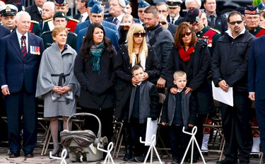 Members of the Cirillo family attend a ceremonial service on Parliament Hill in Ottawa on Thursday, Oct. 22, 2015 to commemorate the attack on and the lives of Corporal Nathan Cirillo and Warrant Officer Patrice Vincent. Errol McGihon/Ottawa Sun/Postmedia Network
