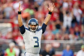 Russell Wilson of the Seattle Seahawks reacts to a play against the San Francisco 49ers during their NFL game at Levi's Stadium in Santa Clara on Oct. 22, 2015. (Ezra Shaw/Getty Images/AFP)
