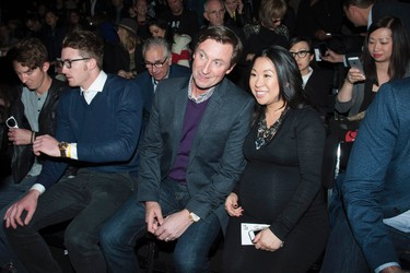 Wayne Gretzky takes his seat before the No. 99 Wayne Gretzky Collection show, part of Fashion Week in Toronto on Thursday October 22, 2015. THE CANADIAN PRESS/Marta Iwanek