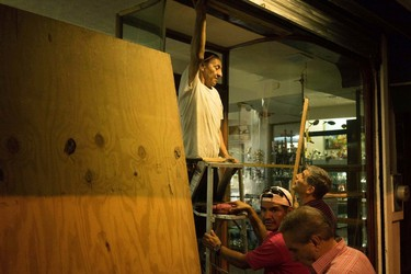 People preparing for the arrival of Hurricane Patricia board up a souvenir shop in the Pacific resort city Puerto Vallarta, Mexico, Thursday, Oct. 22, 2015. (AP Photo/Cesar Rodriguez)