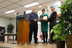 Len Swan accepts his award for business of the year at the Vermilion and District Chamber of Commerce's awards gala on Thursday, Oct. 22. Swan is the owner of Len's Party Bus.