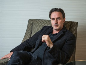David Arquette, who will star in the theatrical production of Sherlock Holmes,  poses for a photo in downtown Toronto on Tuesday October 20, 2015. (Ernest Doroszuk/Postmedia Network)