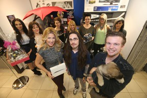 Front row from left; Buffy, Kyle Jahns, and Shael Lander in front of the 360 Hair and Nails staff.  Jahns, and the puppy, are with the Humane Society, the salon has teamed up to raise money for the Humane Society.  The event is called Cause for Paws.