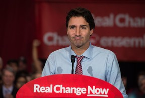 Canadian Liberal Party leader Justin Trudeau speaks at a victory rally in Ottawa on October 20, 2015 after winning the general elections.  Trudeau will face immediate pressure to deliver on election promises, from tackling climate change to legalizing marijuana. AFP PHOTO/ NICHOLAS KAMM