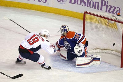 Edmonton Oilers' goaltender Anders Nilsson (39) is scored on by Washington Capital's  Washington Capitals forward Nicklas Backstrom (19) during 1st period NHL action at Rexall Place in Edmonton, Alberta on October 21, 2015. Perry Mah/Edmonton Sun/Postmedia Network