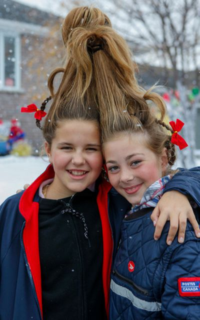 Twelve-year-old neighbours Serenity and Brook became Who's for the night. The town of St. George, Ont., and thousands from the surrounding areas have come together to bring an early Christmas to seven-year-old Evan Leversage. Dave Thomas/Toronto Sun/Postmedia Network